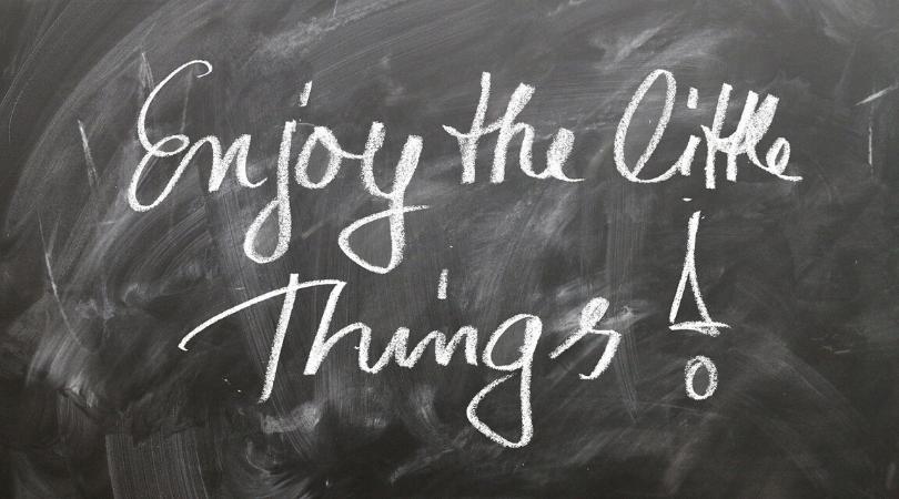 enjoy the little things! written on a blackboard