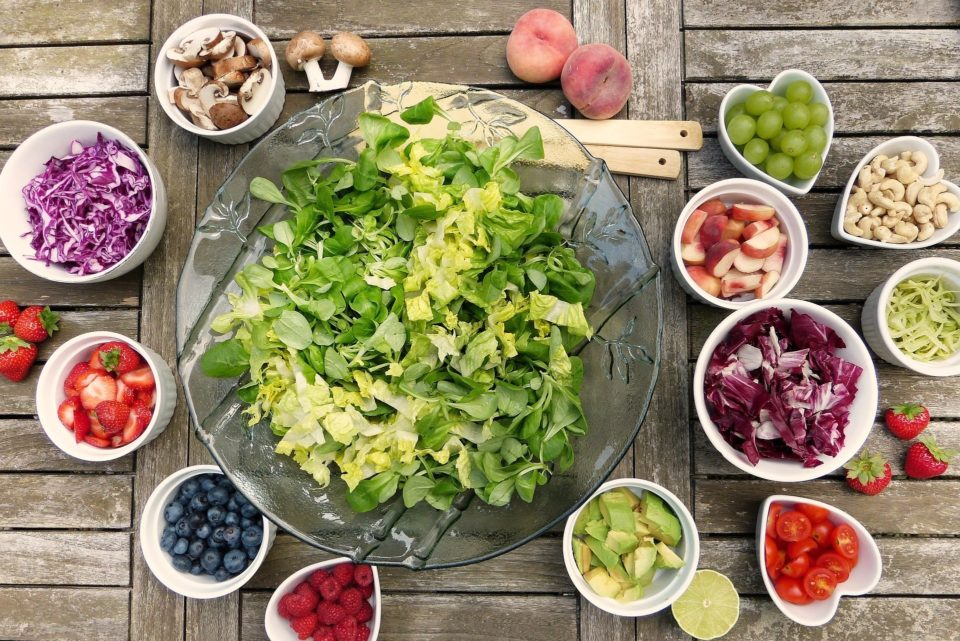 salad and fruits on a table