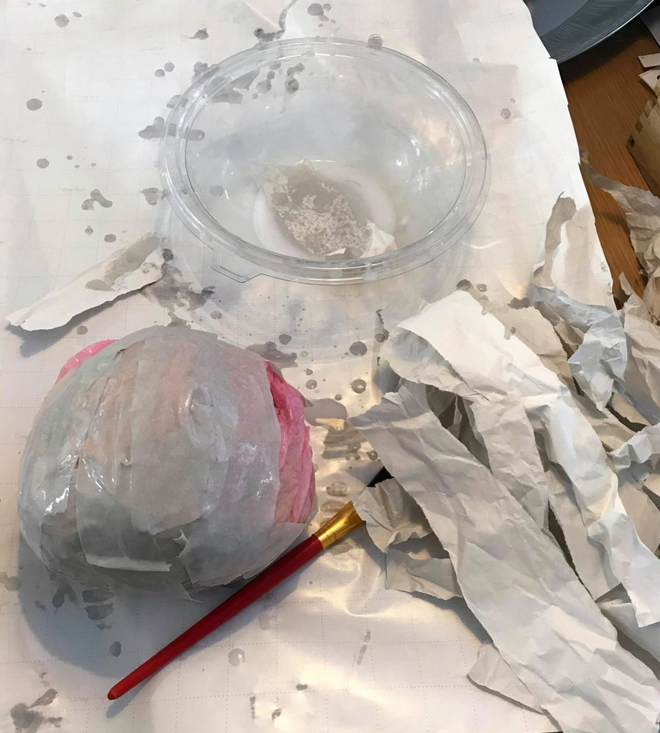glue and water with the planet and shredded paper
