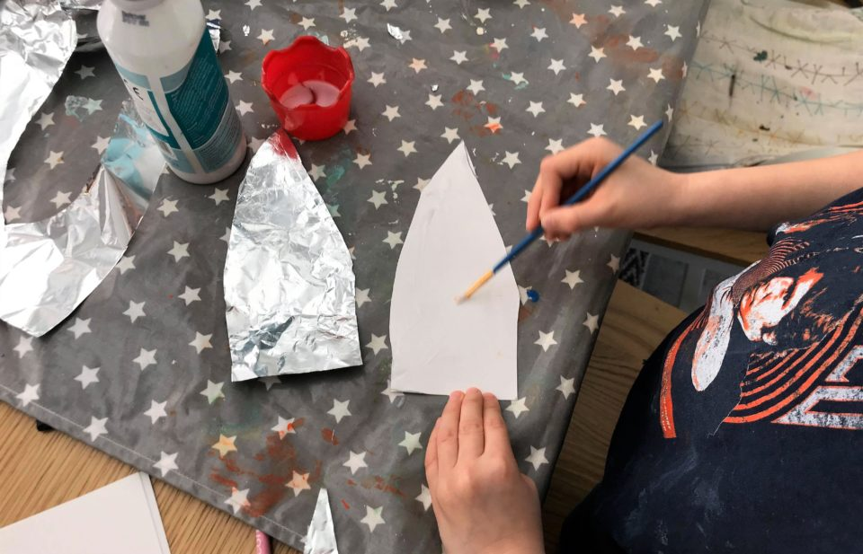 Jake glueing his foil to his rocket