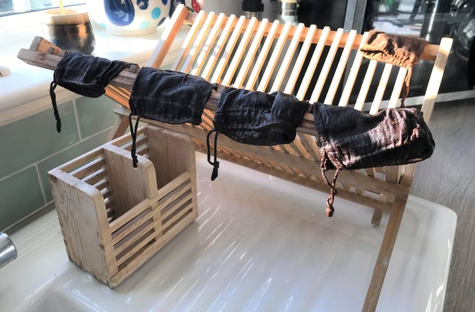 reusable tea bags drying on the wooden stand