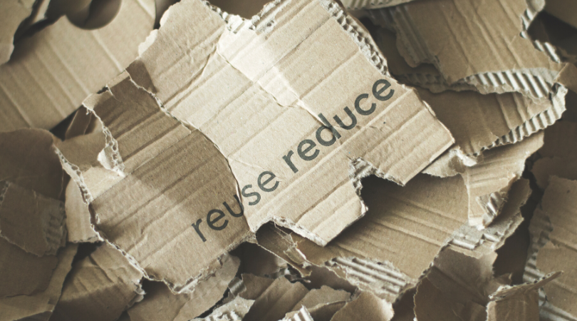 reuse and reduce written on cardboard