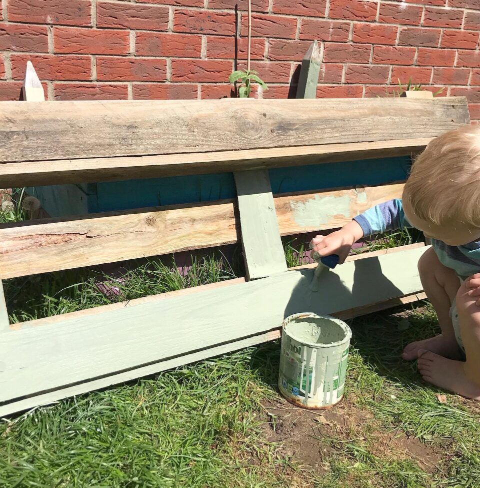William painting the pallet planter
