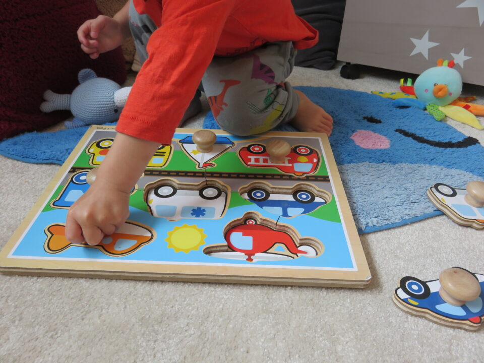William doing his wooden Melissa and Doug puzzle