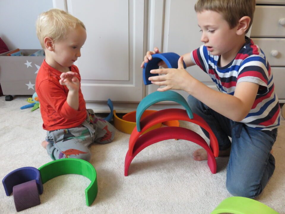 the boys playing with the Grimms rainbow