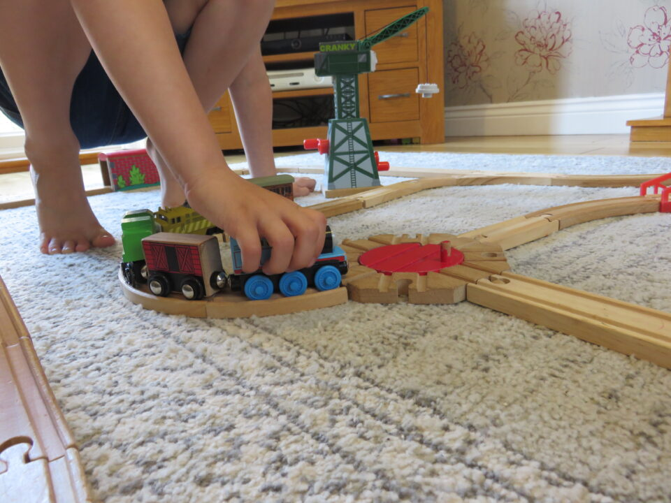 the brio train track closer up being played with