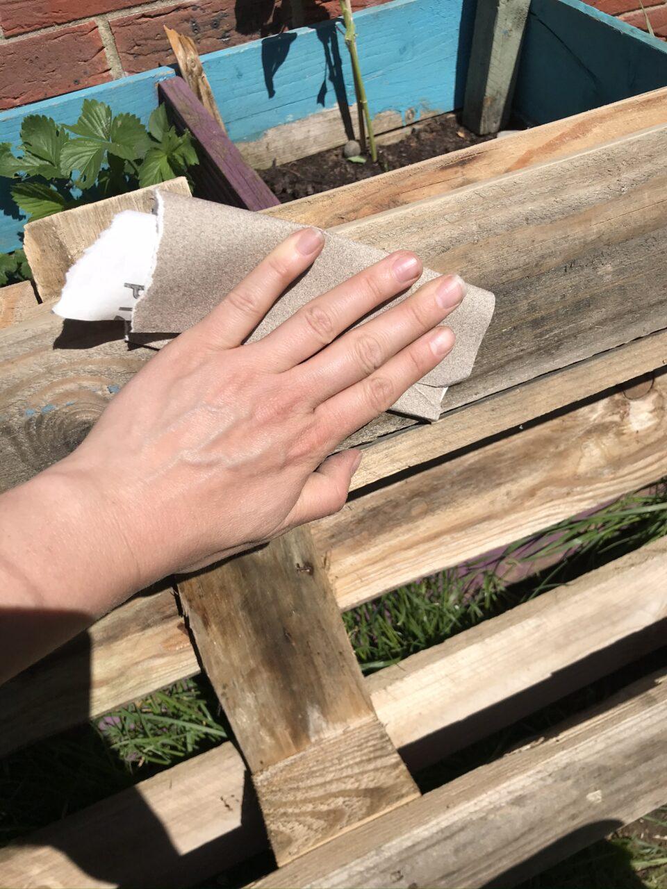 sanding the pallet planter