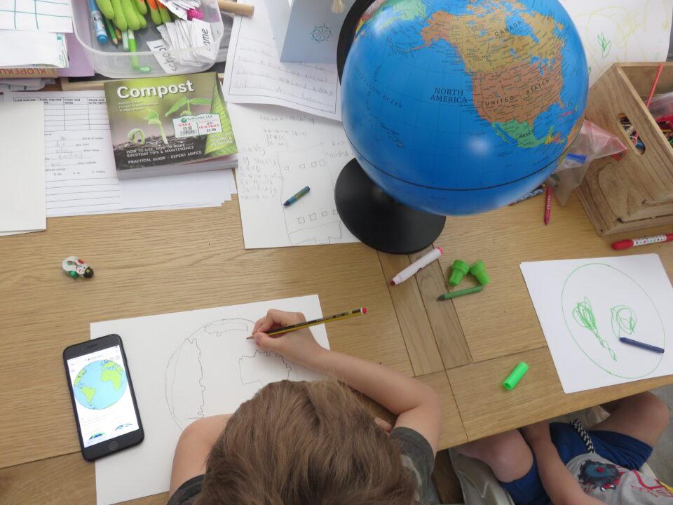 Jake drawing the world