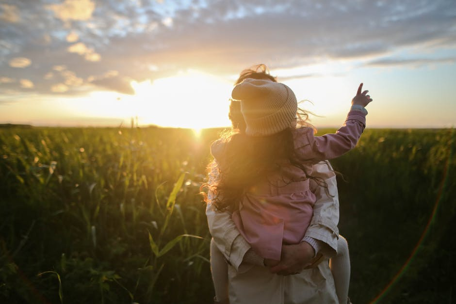 mum and child at sunset in a field