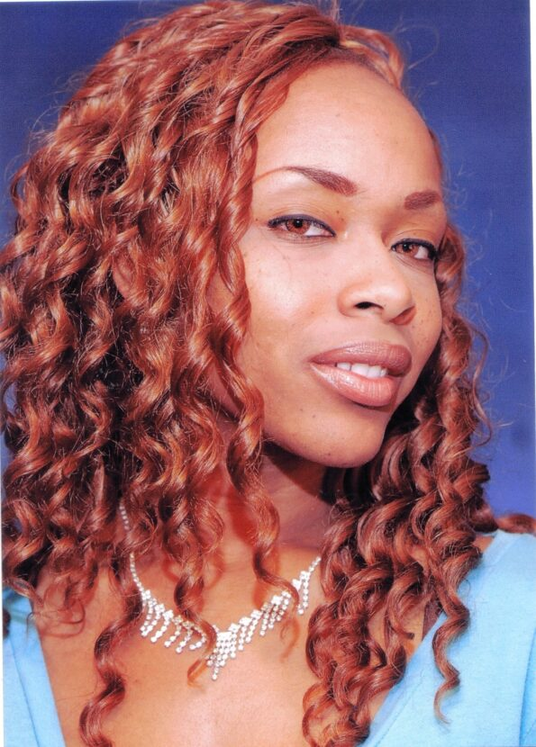a black lady with gorgeous amber ringlets in her hair