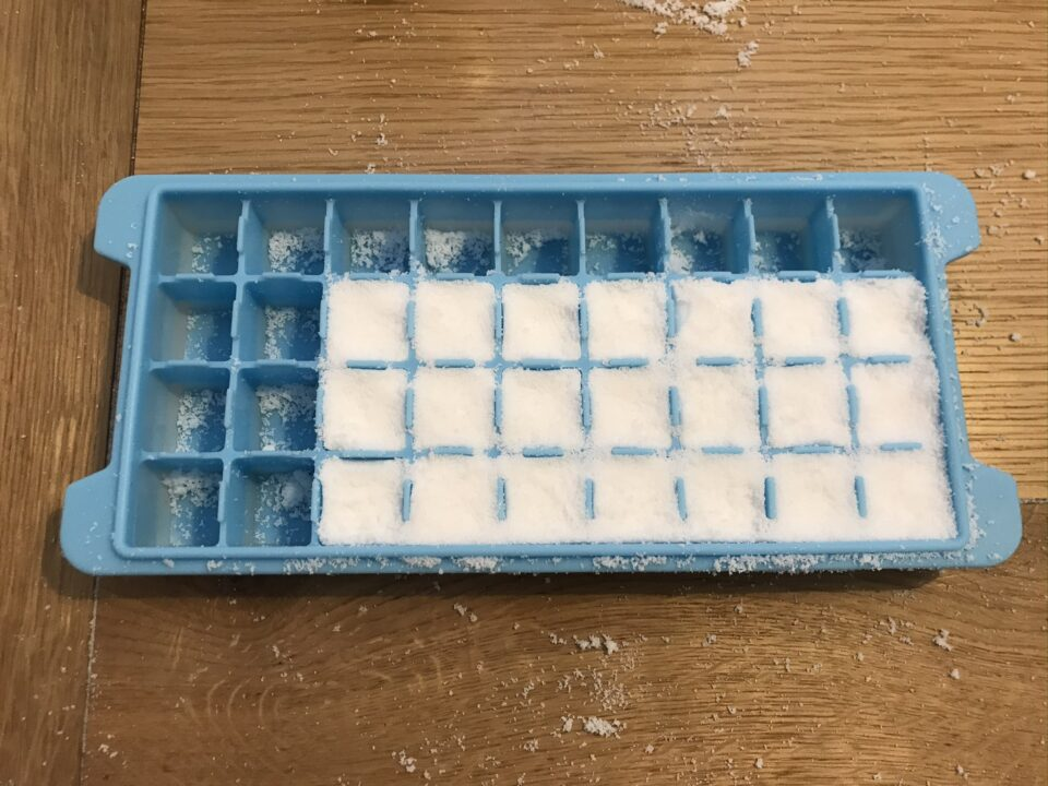 The mixture now pressed down into the silicone moulds