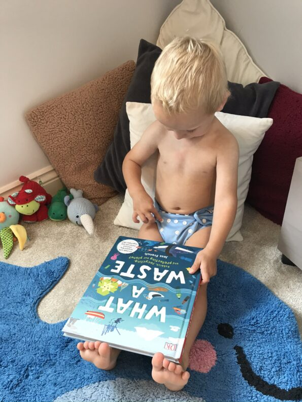 William in his nappy reading a book