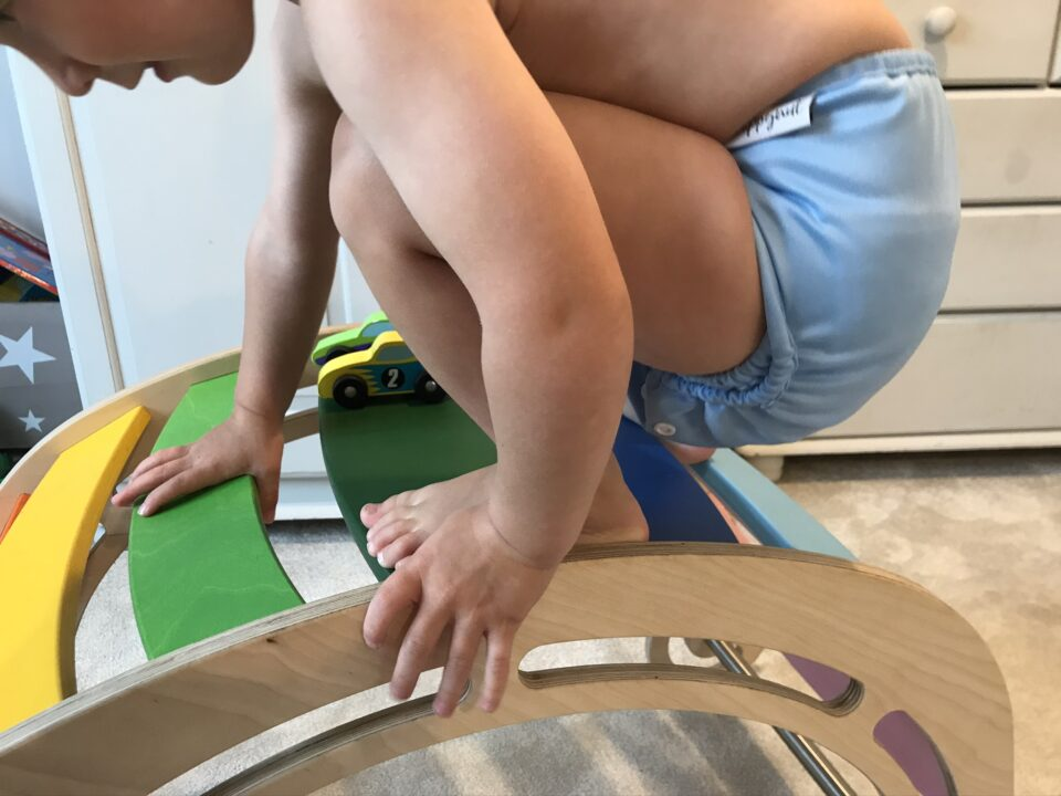 William in his hippynut nappy on his wooden climber