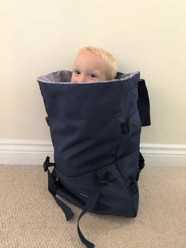 toddler inside the lazy bear backpack