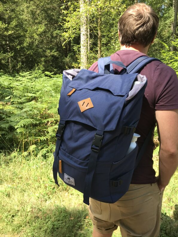 the lazy bear lance navy backpack being worn