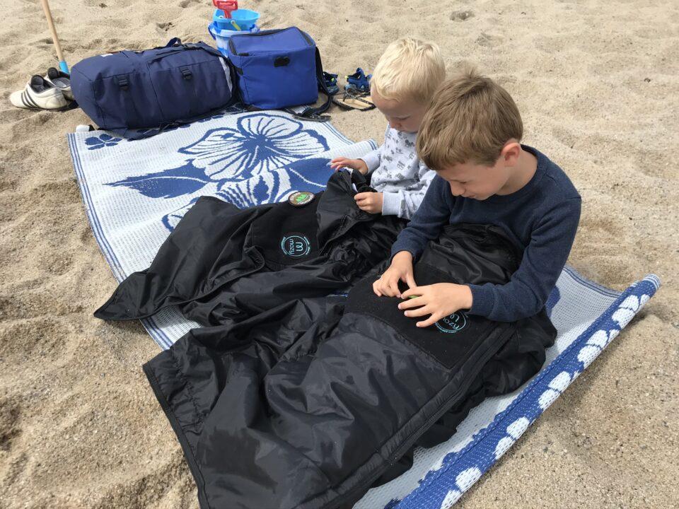 the boys sat on the beach in the Mozy's