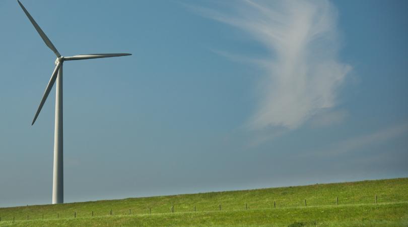 wind farm on a green hill