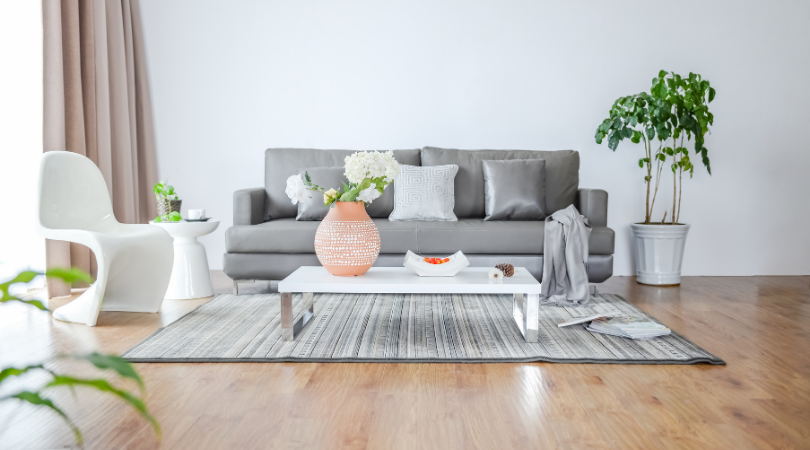 a living room with a grey sofa