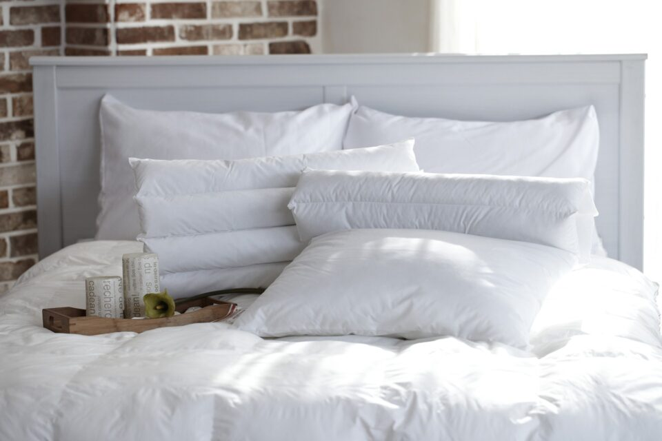 a white bed with pillows
