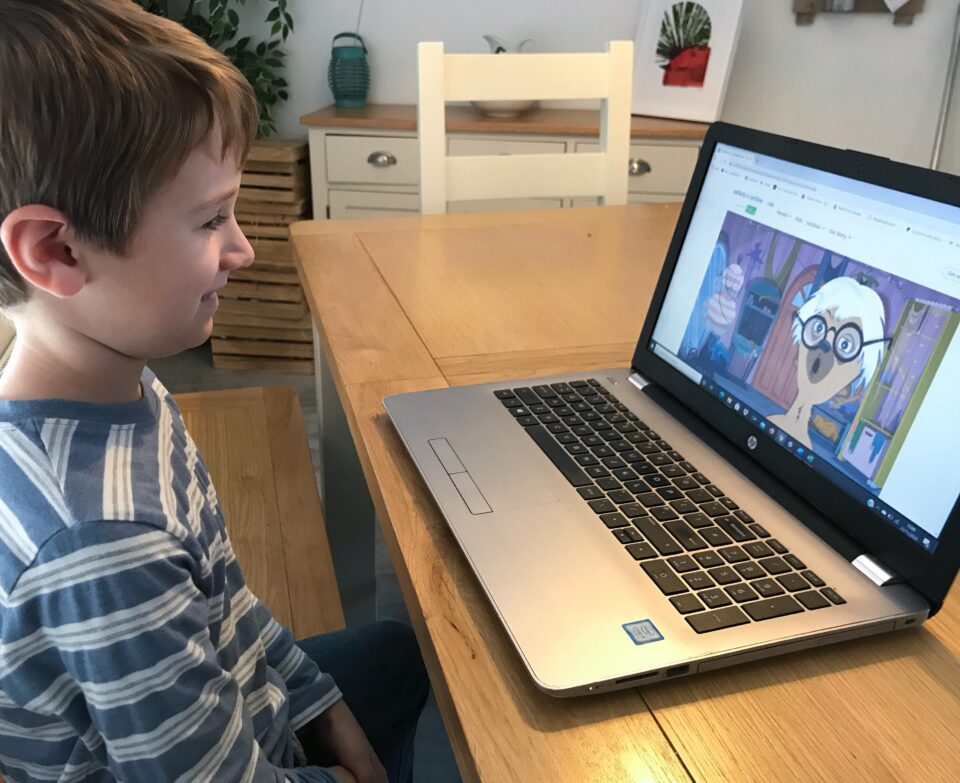 Jake on the Safer Kids Online website watching a video