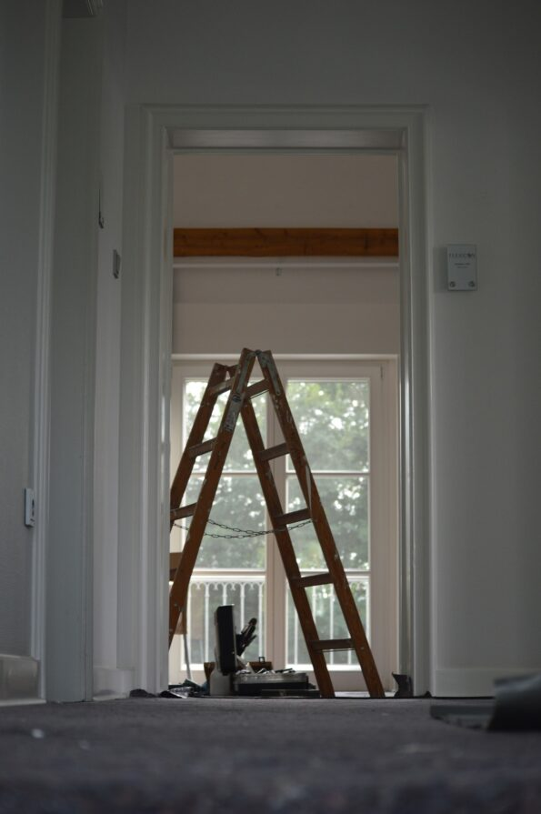 a ladder in a room being renovated