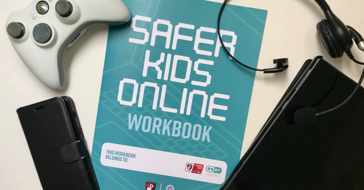 safer kids online workbook with a mobile phone, headset, tablet and game controller around it