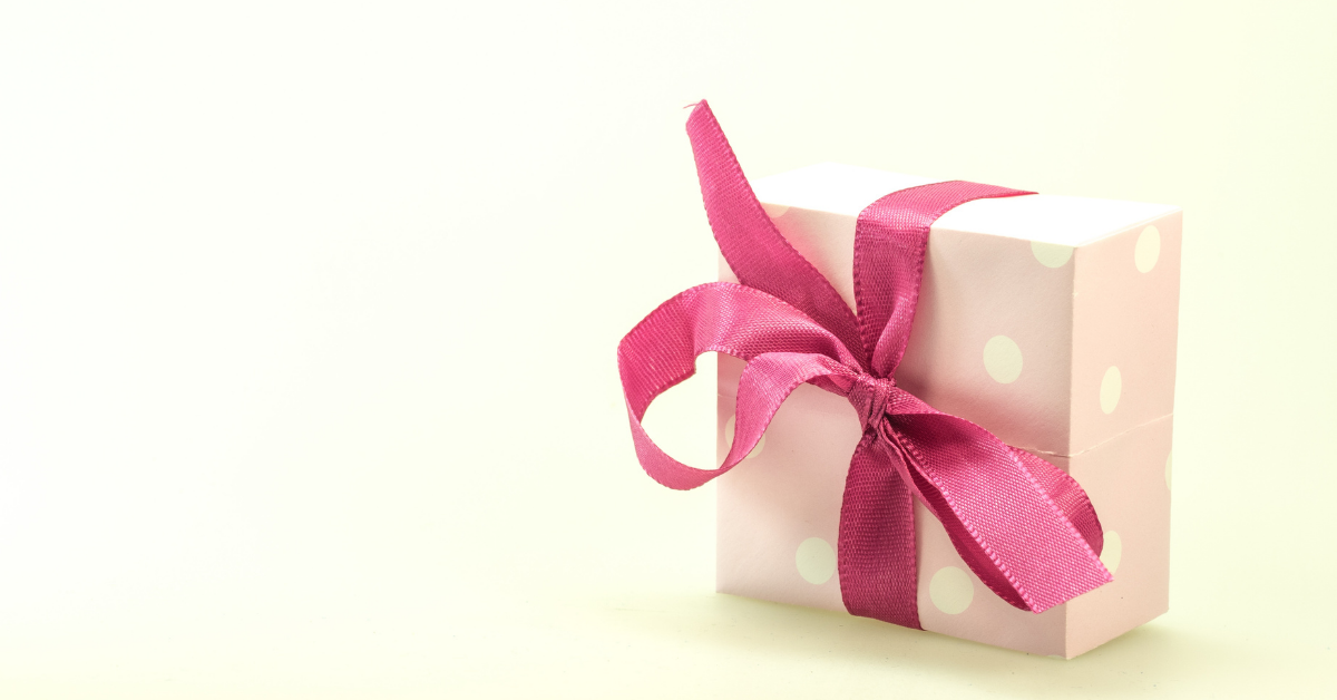a gift with a pink ribbon