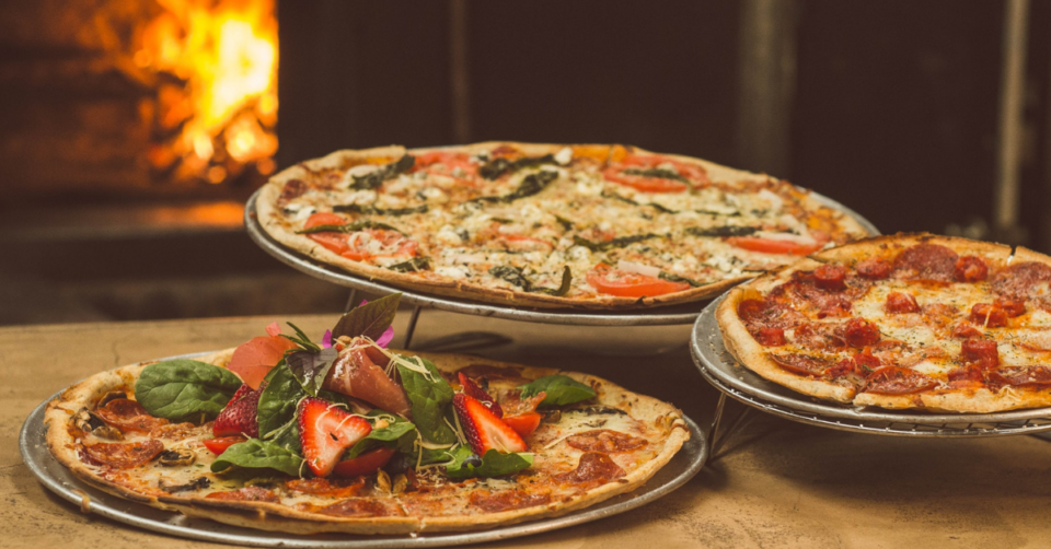 pizza's and a pizza oven