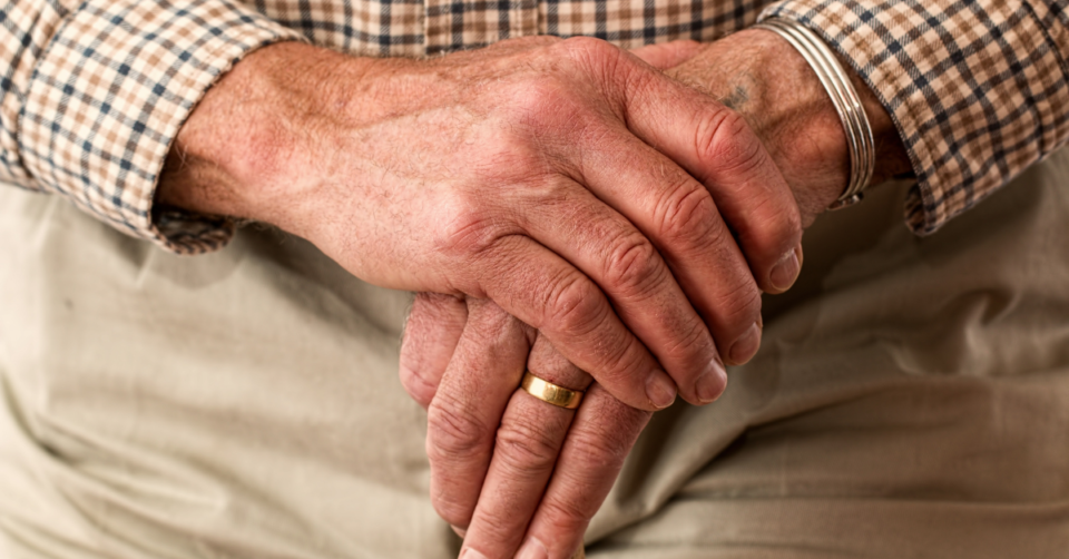 mens hands holding one another