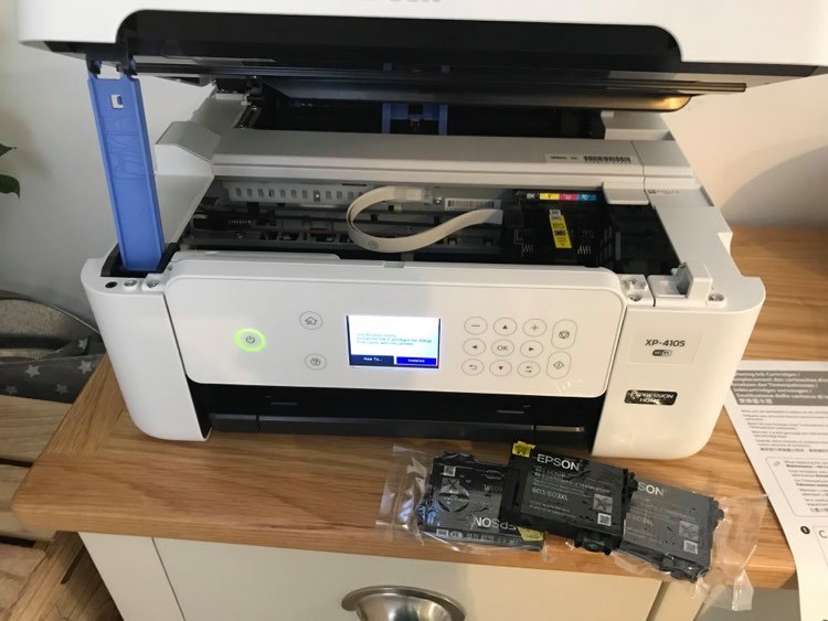 the printer being set up with the ink cartridges in front of it