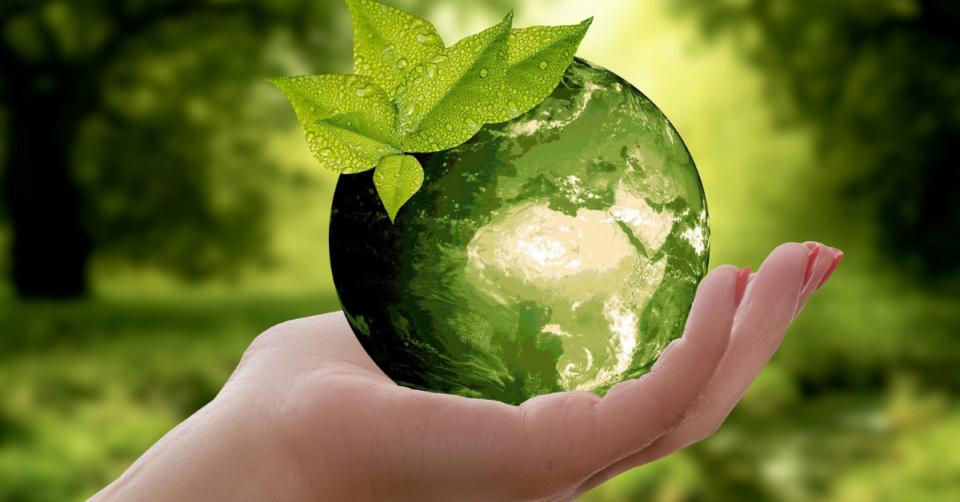 glass earth ina hand