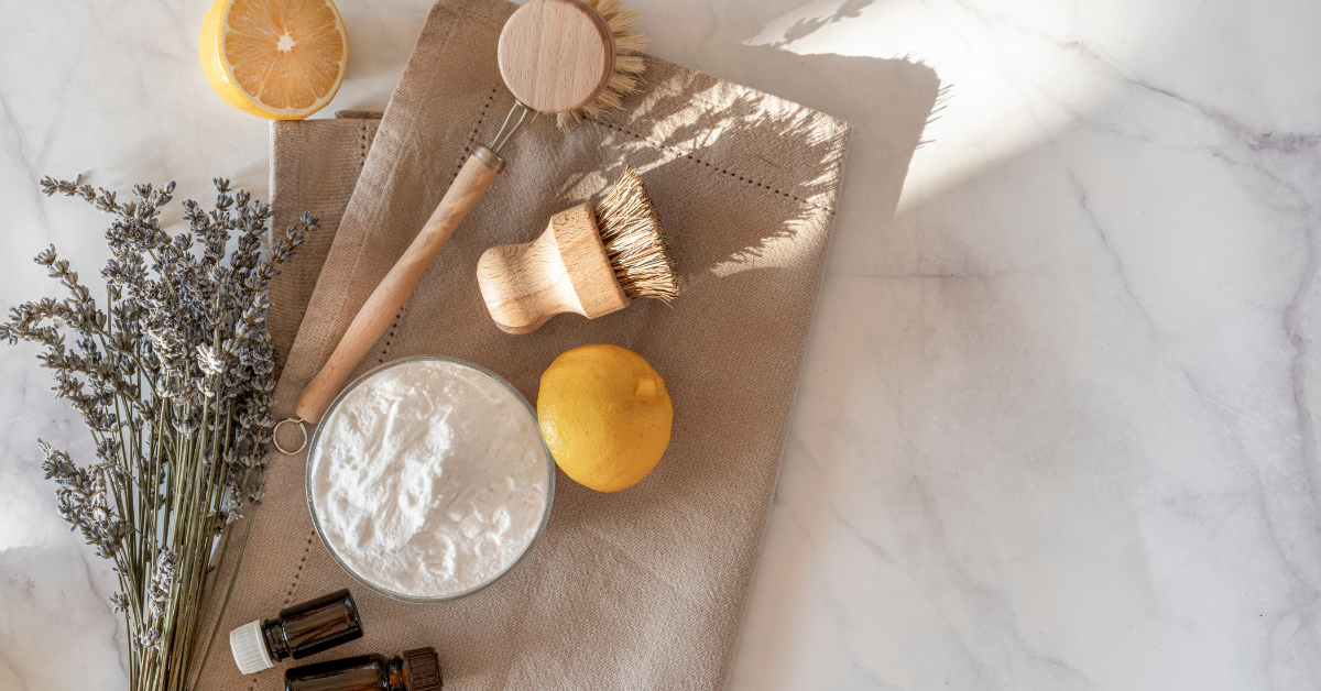 natural cleaning products laid out on a canvas bag with wooden scrubbers