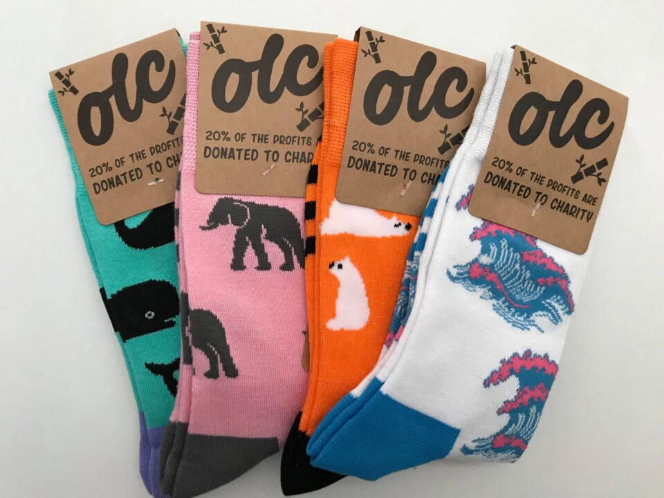 the OLC socks in their packaging laid out on a white background