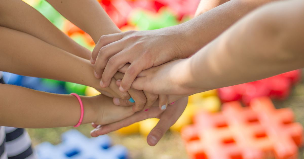 children's hands in a circle