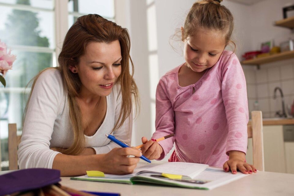 mum helping her daughter with homework