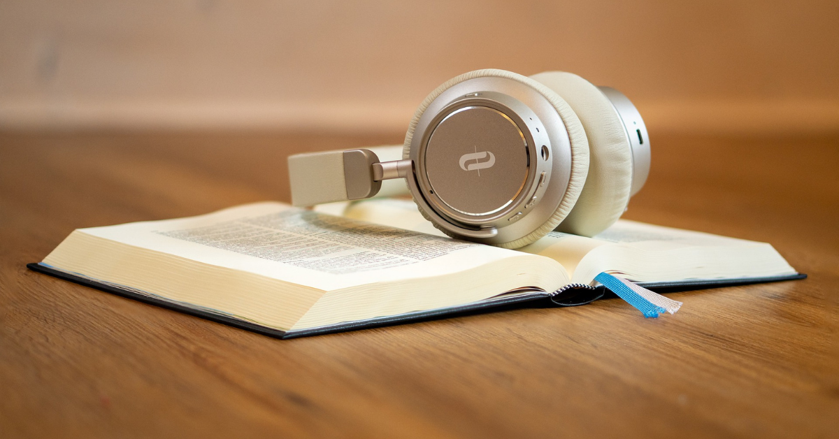book with a set of headphones on the top