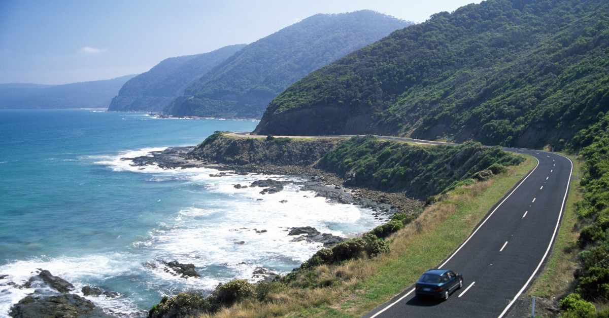 a coastal drive with a car on a road