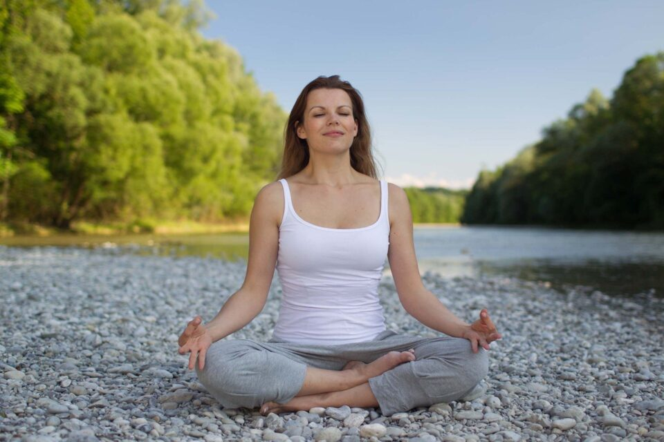 a lady sat cross legged doing yoga