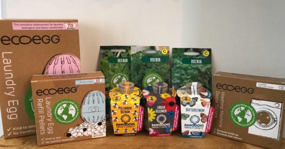 ecoegg, seedbombs and seeds on a wooden shelf