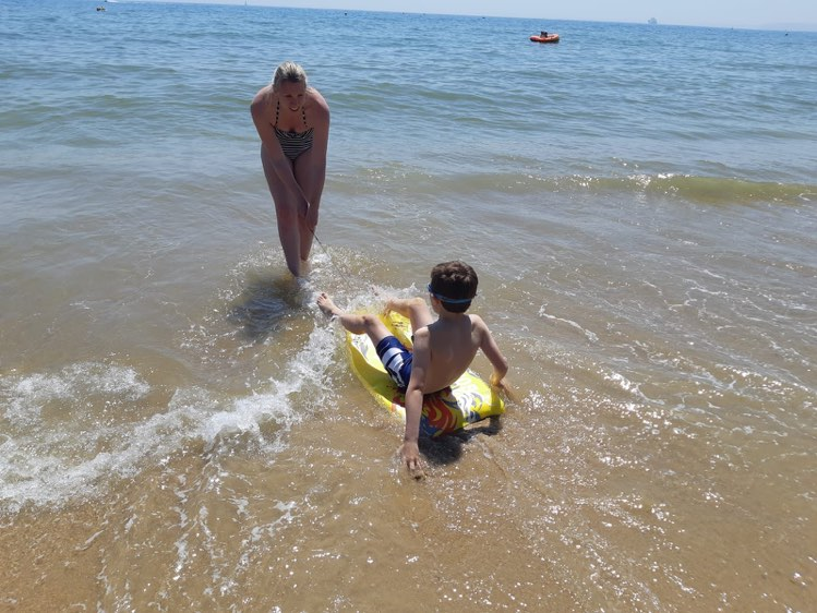 me pulling Jake on his body board