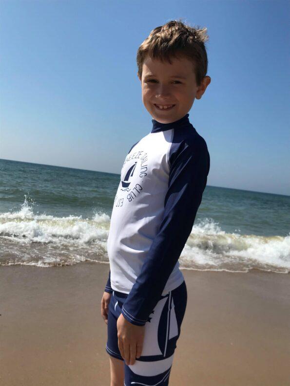 Jake wearing his swimwear on the beach