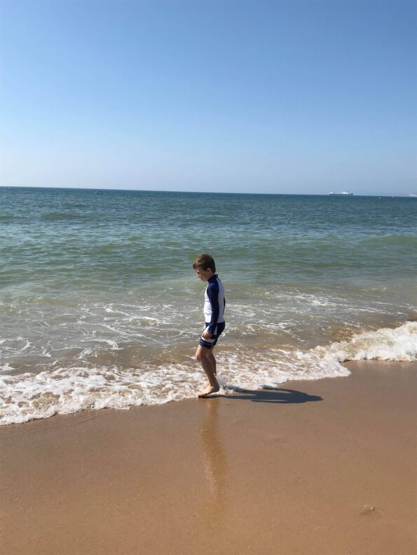 Jake stepping in the sea