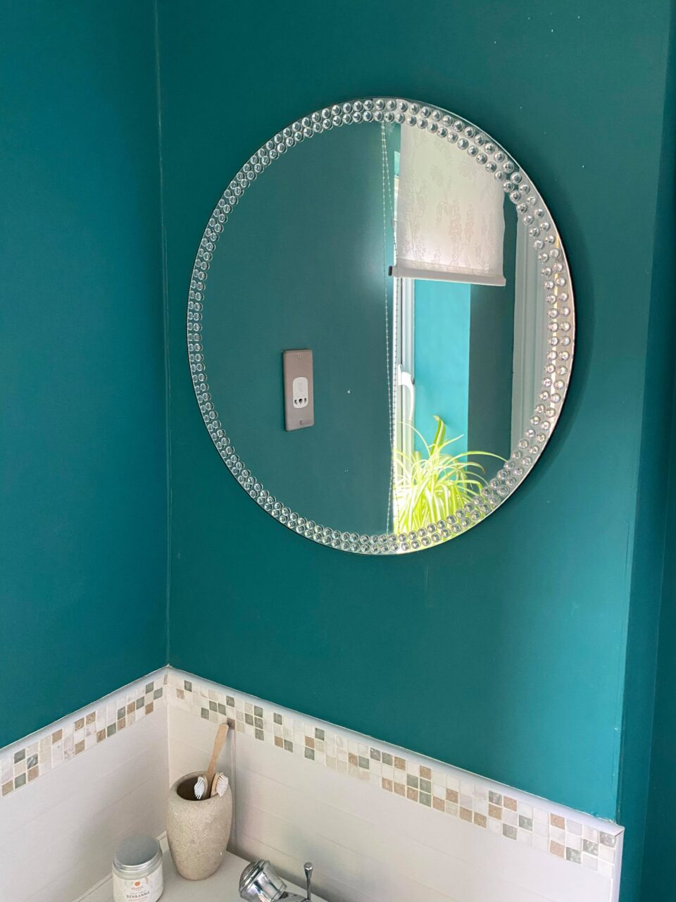 the mirror in our updated bathroom