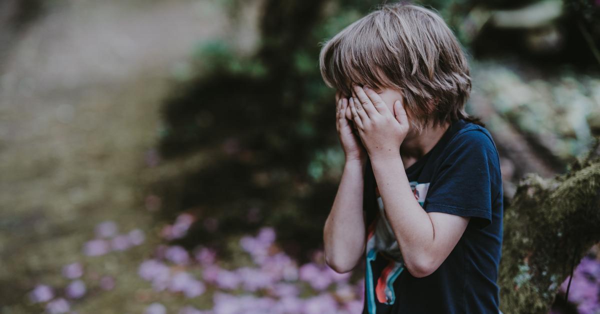a child hiding their eyes