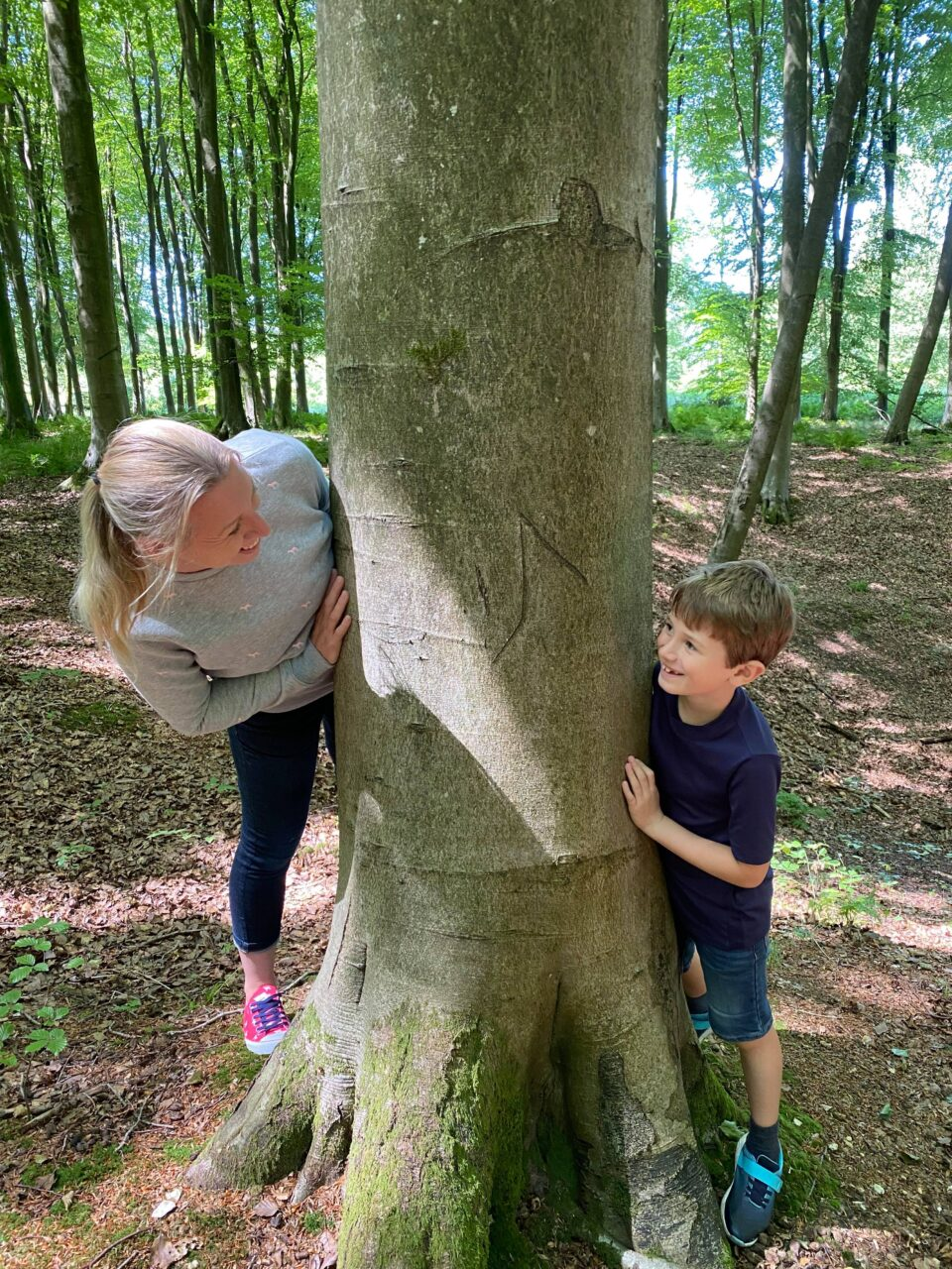 me and Jake (7) looking at one another around a tree