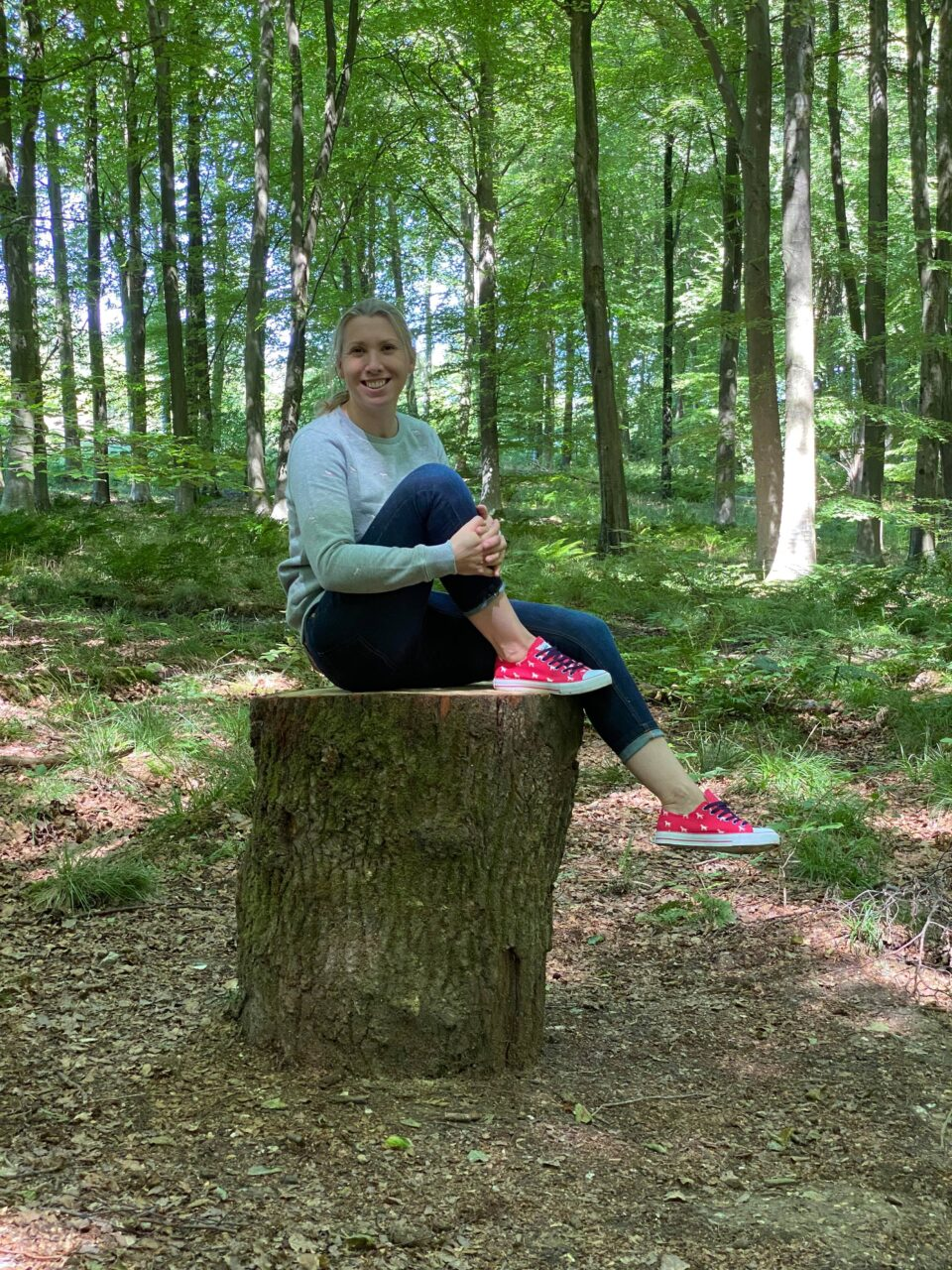 me sitting on a log in the woods wearing my Rydale clothing