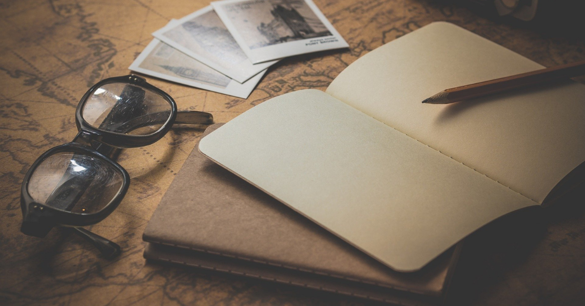 travel budget planning with a notebook and map