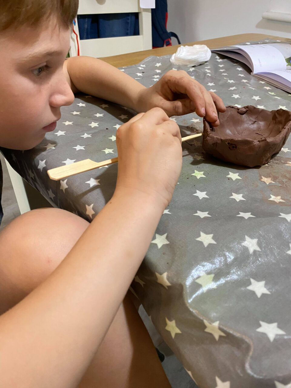 Jake adding his detail to his clay hedgehog