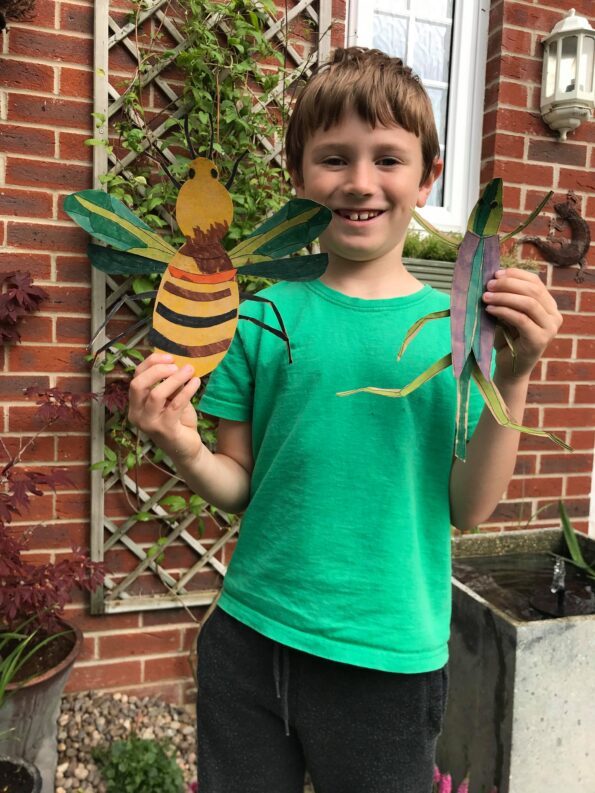 Jake holding up the finished insect projects