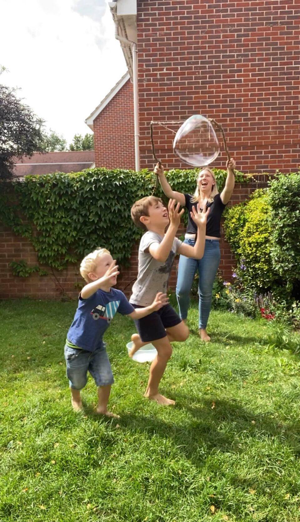 boys chasing bubbles